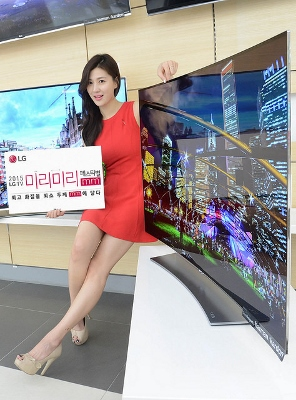 LG girl in red dress with big screen TV's