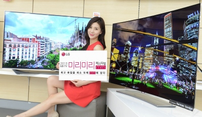 LG girl in red dress by big screen TV